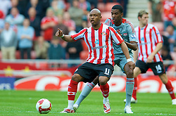 SUNDERLAND, ENGLAND - Saturday, August 16, 2008: Liverpool's Damien Plessis and Sunderland's El-Hadji Diouf during the opening Premiership match of the season at the Stadium of Light. (Photo by David Rawcliffe/Propaganda)