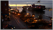 A container ship sails up the Savannah River past historic River Street towards the Port of Savannah Monday Nov. 24, 2008 in Savannah, Ga. (Stephen Morton for The New York Times)