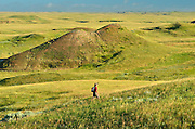 Hiking in the grasslands. MR<br /> Grasslands National Park<br /> Saskatchewan<br /> Canada