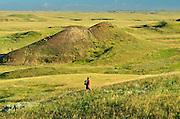 Hiking in the grasslands. MR<br /> Grasslands National Park<br /> Saskatchewan<br /> Canada