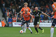 York City midfielder Russell Penn and Luton Town midfielder Luke Guttridge  during the Sky Bet League 2 match between Luton Town and York City at Kenilworth Road, Luton, England on 10 October 2015. Photo by Simon Davies.