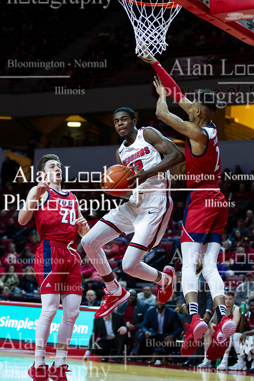 NORMAL, IL - December 18: Antonio Reeves shoots after faking defenders Jamie Ahale and Michael Diggins during a college basketball game between the ISU Redbirds and the UIC Flames on December 18 2019 at Redbird Arena in Normal, IL. (Photo by Alan Look)