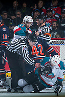 KELOWNA, CANADA - MARCH 31: Linesman Kevin Crowell assists Reid Gardiner #23 of the Kelowna Rockets after a collision with Ondrej Vala #42 of the Kamloops Blazers on March 31, 2017 at Prospera Place in Kelowna, British Columbia, Canada.  (Photo by Marissa Baecker/Shoot the Breeze)  *** Local Caption ***