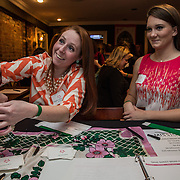 WASHINGTON,DC - MAR20: Margaret Johnson and Jessie Edington, Sweet Briar College alumni, sell drink tickets at a pop-up fundraiser at Mission in Dupont Circle, to save the womens' college in Virginia which will close if it can't raise $250 million dollars, March 20, 2015. (Photo by Evelyn Hockstein/For The Washington Post)