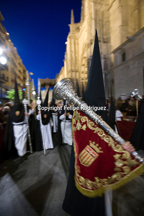 Penitent bearing a bocina or ornamental trumpet during a Holy Week procession, Seville, Spain