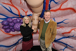 © Licensed to London News Pictures. 01/11/2012. Bristol, UK.  A Alison Bennett, a Macmillan lung cancer nurse specialist, and Malcolm Edmonds who has been treated for lung cancer at the Bristol Royal Infirmary, inside a giant pair of inflatable lungs for the launch of lung cancer awareness month for the Roy Castle Lung Cancer Foundation.  Alison works at Barnsley District Hospital and was in Bristol for the National Lung Cancer Forum for nurses.  01 November 2012..Photo credit : Simon Chapman/LNP