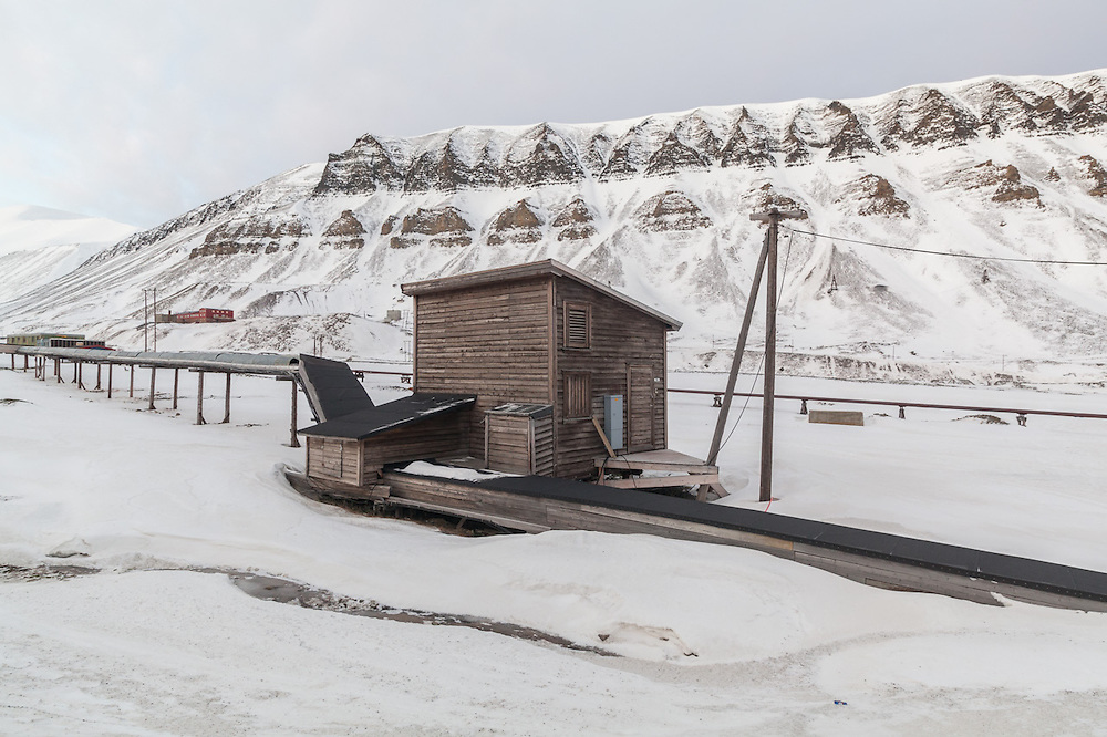 Utility pipes and pump station in Longyearbyen, Svalbard. The water pipes are heated and above ground to prevent freezing and protect the permafrost.