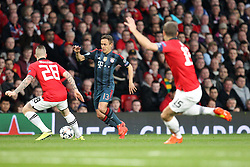 01.04.2014, Old Trafford, Manchester, ENG, UEFA CL, Manchester United vs FC Bayern Muenchen, Viertelfinale, Hinspiel, im Bild l-r: im Zweikampf, Aktion, mit Alexander Buettner #28 (Manchester United), Rafinha #13 (FC Bayern Muenchen) und Nemanja Vidic #15 (Manchester United) // during the UEFA Champions League Round of 8, 1nd Leg match between Manchester United and FC Bayern Muenchen at the Old Trafford in Manchester, Great Britain on 2014/04/01. EXPA Pictures © 2014, PhotoCredit: EXPA/ Eibner-Pressefoto/ Kolbert<br /> <br /> *****ATTENTION - OUT of GER*****