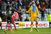 Plymouth Argyle's Jamille Matt shakes hands with York City Goalkeeper Scott Flinders after the final whistle with the home team winning 3-2 in the Sky Bet League 2 match between Plymouth Argyle and York City at Home Park, Plymouth, England on 28 March 2016. Photo by Graham Hunt.