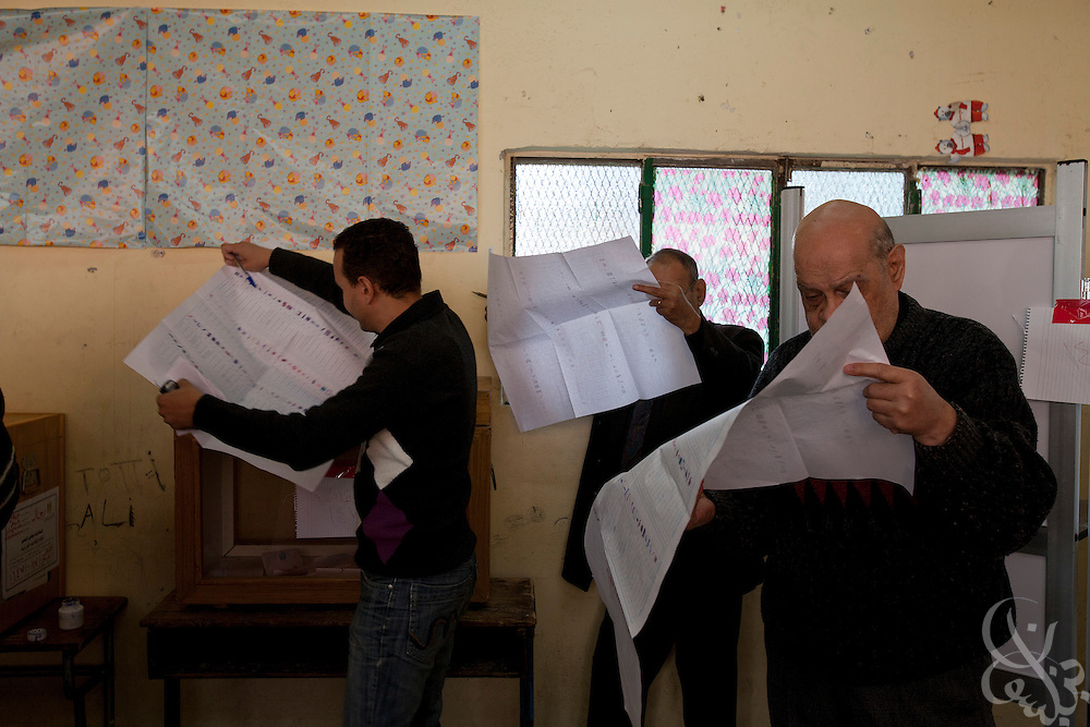 Egyptian voters mark their ballot choices as they take part in historic free parliamentary elections Nov 28, 2011 at a polling station in the Shubra district of the capital, Cairo. The first round of voting (1 of three) for the election, the first since the revolution in Egypt that ousted former president Hosni Mubarak earlier in the year, saw very high voter turnout and is hoped to be a positive step in the direction of a new democratic spirit for the country. (Photo by Scott Nelson)