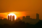UNITED KINGDOM, London: 13 May 2015 The London skyline stands in front of an orange sky and a rising sun from Richmond Park, London this morning. Although it was a cold start to the day, temperatures are set to get up to 20C. Rick Findler  / Story Picture Agency
