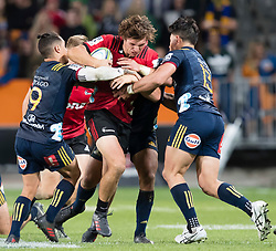 Crusaders' George Bridge, centre, takes the ball into the tackle against the Highlanders in the Super Rugby match, Forsyth Barr Stadium, Dunedin, New Zealand, Saturday, March 17, 2018. Credit:SNPA / Adam Binns ** NO ARCHIVING**