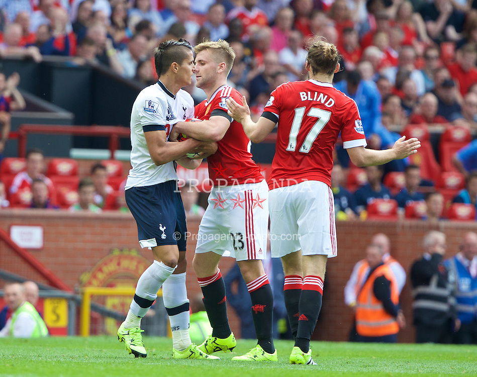 MANCHESTER, ENGLAND - Saturday, August 8, 2015: Tottenham Hotspur's Erik Lamela and Manchester United's Luke Shaw tussle for the ball during the Premier League match at Old Trafford. (Pic by David Rawcliffe/Propaganda)