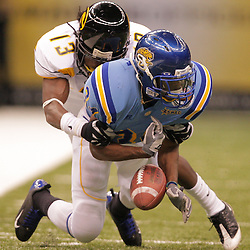 2008 November, 29: Grambling State cornerback Kenneth Anio (13) forces a fumble by Southern University running back Brian Threat (34) during the first half of the 35th annual State Farm Bayou Classic between Southern University and Grambling State University at the Louisiana Superdome in New Orleans, LA.  .