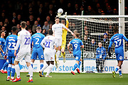 Peterborough Utd goalkeeper Conor O'Malley (25) collects the ball under pressure during the EFL Sky Bet League 1 match between Peterborough United and Coventry City at London Road, Peterborough, England on 16 March 2019.
