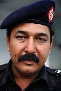 Moinuddin Syed, 42, the AVCC (Anti-Violence Crime Cell) second in command, is portrayed while at their headquarters in Karachi, Pakistan. The AVCC is a special police unit mostly involved in anti-terrorism operations and kidnap cases in the city and its vicinity.
