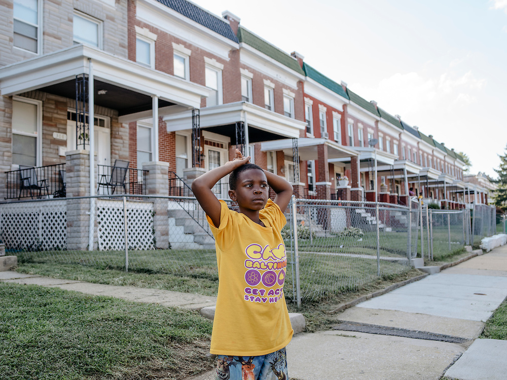 Isaiah Latham, 8, plays on his block, the same street Odell Newton grew up on.