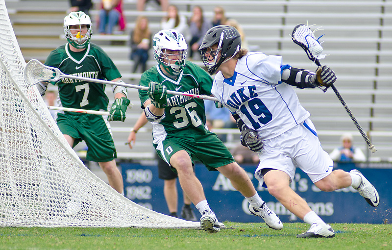 March 20 2011:Duke attack Christian Walsh (19) drives on goal guarded by Dartmouth defender Evan Bloom (36)