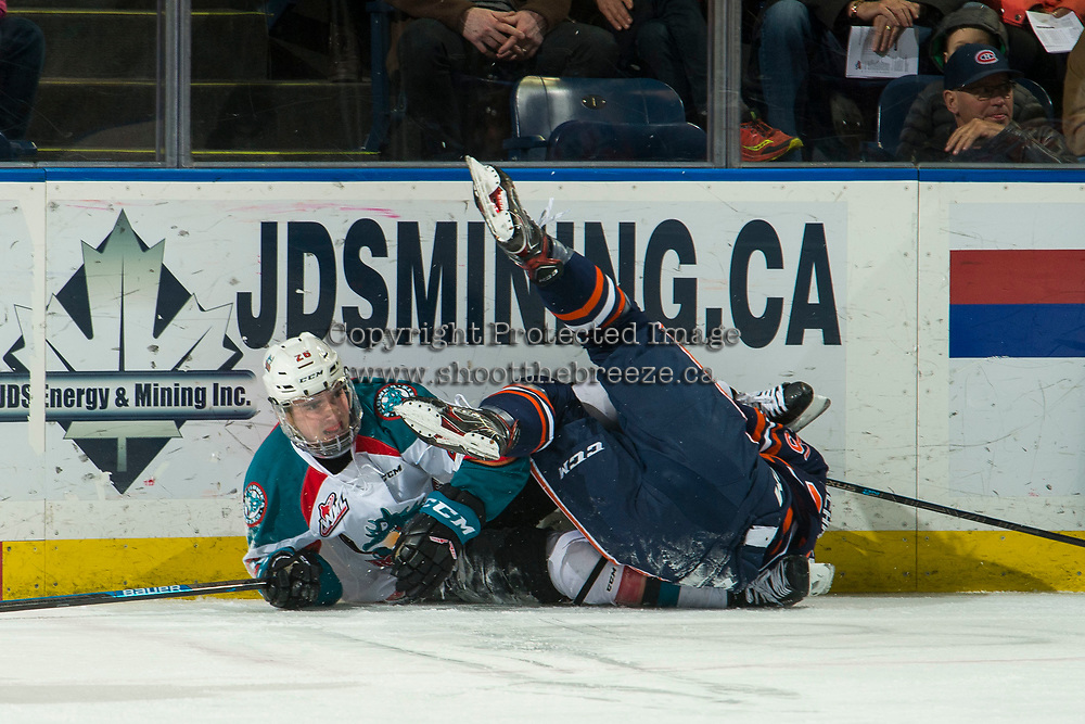 KELOWNA, CANADA - FEBRUARY 23:  Liam Kindree #26 of the Kelowna Rockets gets tangled up with a player from the Kamloops Blazers on February 23, 2019 at Prospera Place in Kelowna, British Columbia, Canada.  (Photo by Marissa Baecker/Shoot the Breeze)
