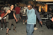 People dancing, partying, and have a good time at Lee Jones's open air Sundae dance party in 2009. This weekly event is held at the the Piazza at Schmidt's in Northern Liberties in Philadelphia each Sunday. Photos in those group are from Sundae vs. Aquabooty. Oscar P was the DJ spinning.