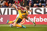 Arsenal defender Shkodran Mustafi (20)  tackles Burnley forward Sam Vokes (9)  during the Premier League match between Burnley and Arsenal at Turf Moor, Burnley, England on 2 October 2016. Photo by Simon Davies.