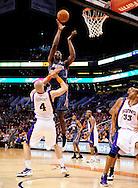 Feb. 4, 2012; Phoenix, AZ, USA; Charlotte Bobcats forward Bismack Biyombo (0) drives the ball against the Phoenix Suns center Marcin Gortat (4) during the first half at the US Airways Center. Mandatory Credit: Jennifer Stewart-US PRESSWIRE.
