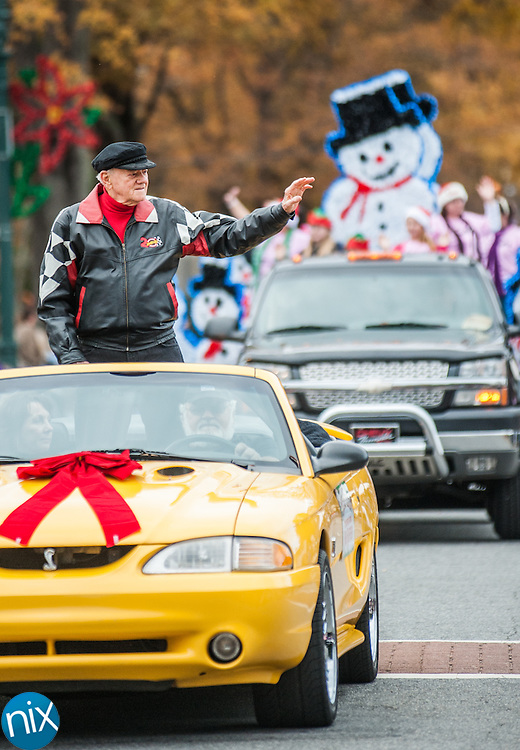Broadcaster and Concord native Bob Raiford waives to the crowd during the 2013 Concord Christmas parade along Church Street and Union Street Saturday afternoon.