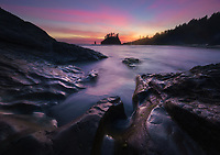 Colorful clouds light up the sky after sunset on Second Beach in Olympic National Park, WA, USA