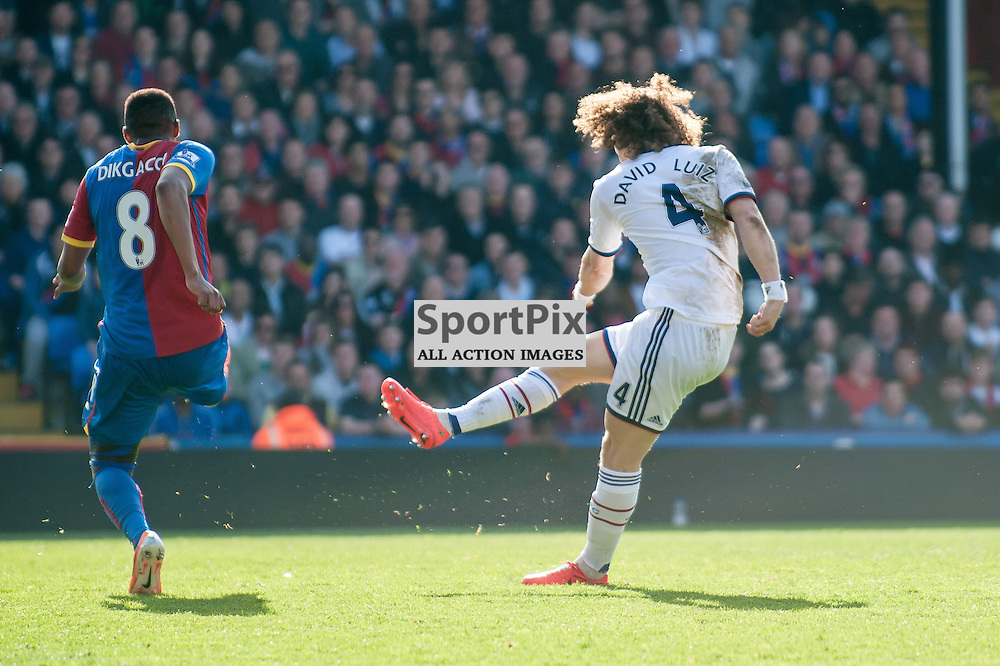 Chelsea's David Luiz shoots at goal under pressure from Crystal Palace's Kagisho Dikgacoi. Action from Crystal Palace v Chelsea in the Premier League game at Selhurst Park in LONDON, 29 March 2014. (c) Paul J Roberts / Sportpix.org.uk