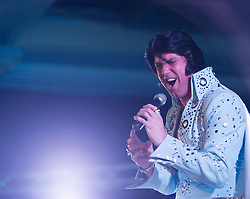 © Licensed to London News Pictures. 07/01/2012. BIRMINGHAM, UK.  Gary J Bower performs in the final at the annual European Elvis Championship at the Hilton Metropole Hotel at the National Exhibition Centre today.  He is one of over a hundred individual acts all hoping ot win the chance to take part in the International Elvis Tribute Artist Contest, to be held this summer in Memphis.   Photo credit: Alison Baskerville/LNP