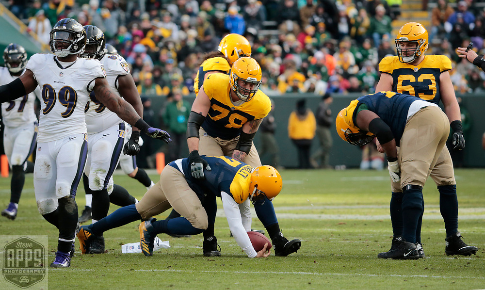 Green Bay Packers offensive tackle Jason Spriggs (78) helps up Green Bay Packers quarterback Brett Hundley (7) after being sacked in the 4th quarter. <br /> The Green Bay Packers hosted the Baltimore Ravens at Lambeau Field Sunday, Nov. 19, 2017. The Packers lost 23-0. STEVE APPS FOR THE STATE JOURNAL.