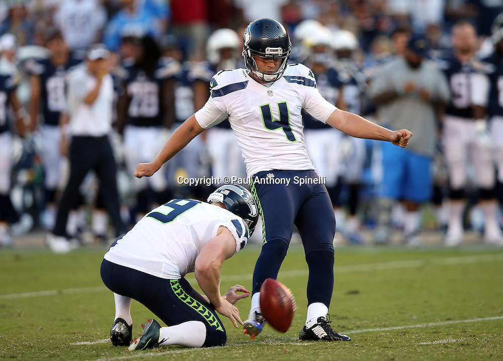 Seattle Seahawks punter Jon Ryan (9) holds while Seattle Seahawks kicker Steven Hauschka (4) kicks a 40 yard second quarter field goal for a 10-6 halftime lead during the 2015 NFL preseason football game against the San Diego Chargers on Saturday, Aug. 29, 2015 in San Diego. The Seahawks won the game 16-15. (©Paul Anthony Spinelli)