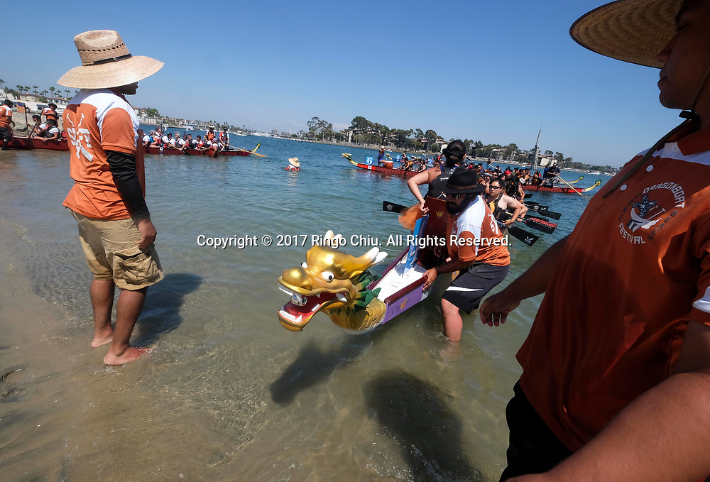 Dragon Boat racers get ready to compete at Long Beach Dragon Boat Festival at Marine Stadium in Long Beach, California, on July 30, 2017. (Photo by Ringo Chiu)<br /> <br /> Usage Notes: This content is intended for editorial use only. For other uses, additional clearances may be required.