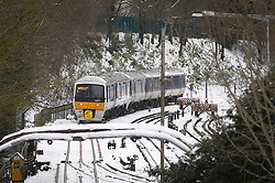 © Licensed to London News Pictures. 11/12/2017. Amersham, UK. A train surrounded by snow at Amersham Station in Buckinghamshire. Transport is being heavily affected across parts of the islands and southern England with British Airways cancelling 30 flights before 10am this morning. Photo credit: Tom Nicholson/LNP