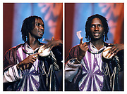 Baaba Maal performs at the Island 50 concerts Hammersmith Empire - London 2009, The talking drum is an hourglass-shaped drum from West Africa, whose pitch can be regulated to mimic the tone and prosody of human speech.