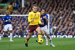 LIVERPOOL, ENGLAND - Sunday, November 14, 2010: Everton's Leighton Baines and Arsenal's Jack Wilshere during the Premiership match at Goodison Park. (Photo by: David Rawcliffe/Propaganda)