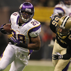 Jan 24, 2010; New Orleans, LA, USA; Minnesota Vikings running back Adrian Peterson (28) runs by New Orleans Saints linebacker Scott Fujita (55) during the first quarter of the 2010 NFC Championship game at the Louisiana Superdome. Mandatory Credit: Derick E. Hingle-US PRESSWIRE