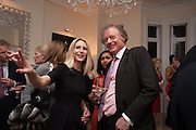 MARY POWYS; RICHARD BRIGGS, Drinks party given by Basia and Richard Briggs,  Chelsea. London. SW3. 13 February 2014.