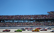 May 7, 2017; Talladega, AL, USA; (Editors note: tilt-shift lens was used to create this image) Drivers go into turn one during the GEICO 500 at Talladega Superspeedway. Mandatory Credit: Peter Casey-USA TODAY Sports