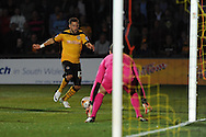 Robbie Willmott of Newport county shoots wide of Cambridge keeper Chris Dunn.  Skybet football league two match, Newport County v Cambridge Utd at Rodney Parade ,Newport , South Wales on Monday 8th  Sept 2014<br /> pic by Andrew Orchard, Andrew Orchard sports photography.