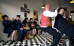 © Licensed to London News Pictures. 14/09/2012. Goodwood, UK A vintage barber shop. People enjoy the atmosphere at the 2012 Goodwood Revival Meeting today 14 September 2012. Participants are encouraged to dress in period dress.. Photo credit : Stephen Simpson/LNP