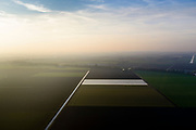 Nederland, Flevoland, Oostelijk Flevoland, 04-11-2018; omgeving Dronten. Akker of bollenveld, afgedekt met landbouwplastic.<br /> Field or bulb field, covered with agricultural plastic, new polder Flevoland.<br /> <br /> luchtfoto (toeslag op standaard tarieven);<br /> aerial photo (additional fee required);<br /> copyright© foto/photo Siebe Swart