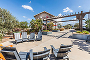 Outdoor Seating with Adirondack Chairs in a Courtyard at The Village at Tustin Legacy
