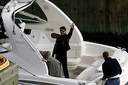 Actor Tom Cruise waves from a boat during a promotional tour of New York for his new movie 'Mission Impossible 3' , Wednesday 03 May 2006. Cruise is attending a number of different events around the city and travelling by a number of different forms of transportation.