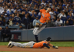 November 1, 2017 - Los Angeles, California, U.S. - Houston Astros shortstop Carlos Correa (1) reacts as third baseman Alex Bregman (2) dives and can't come up with the single by Los Angeles Dodgers' Justin Turner (not pictured) in the 5th inning of game seven of a World Series baseball game at Dodger Stadium on Wednesday Nov. 1, 2017 in Los Angeles.  (Credit Image: © San Gabriel Valley Tribune via ZUMA Wire)