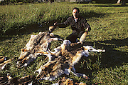 Fur hunter displays his catch. Photographed in Romania