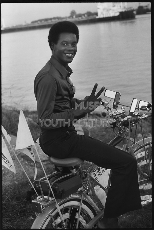 A young man on his bicycle by the banks of the Mississippi, USA, 1980