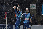 Wycombe Wanderers defender Joe Jacobson (3) scores a penalty and celebrates with Wycombe Wanderers striker Scott Kashket (11) 1-0 during the EFL Sky Bet League 1 match between Wycombe Wanderers and Doncaster Rovers at Adams Park, High Wycombe, England on 23 November 2019.