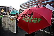 Frankfurt am Main | 18 Mar 2015<br /> <br /> Blockupy-Proteste in Frankfurt am 18.03.2015, hier: Blockupy-Abschlussdemo in der Kurt-Schuhmacher-Strasse, Schirm mit der Aufschrift &quot;Resist Sister&quot;.<br /> <br /> photo &copy; peter-juelich.com