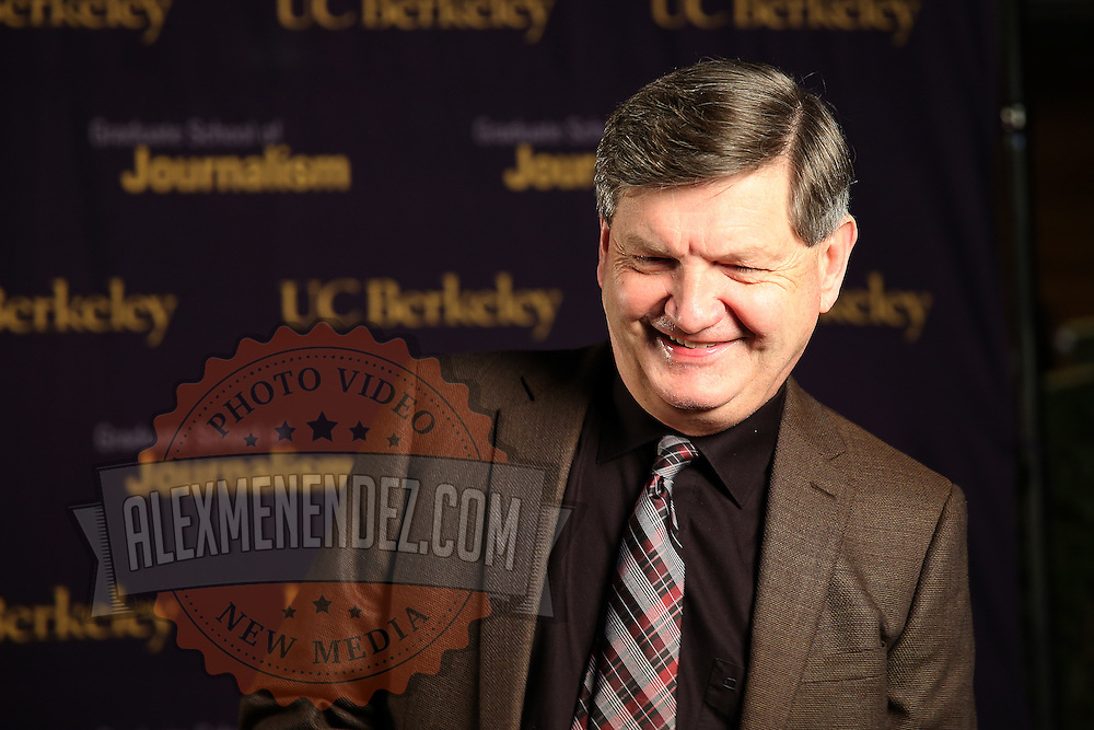 """Reporter James Risen speaks to a television reporter prior to the """"Prosecuting the Press"""" event at the UC Berkeley Graduate School of Journalism in Berkeley, California, on Thursday, November 14, 2013. Risen, the New York Times national security reporter is facing jail for refusing to comply with a subpoena to reveal his sources in relation to his book titled State of War: The Secret History of the CIA and the Bush Administration. (AP Photo/Alex Menendez)"""